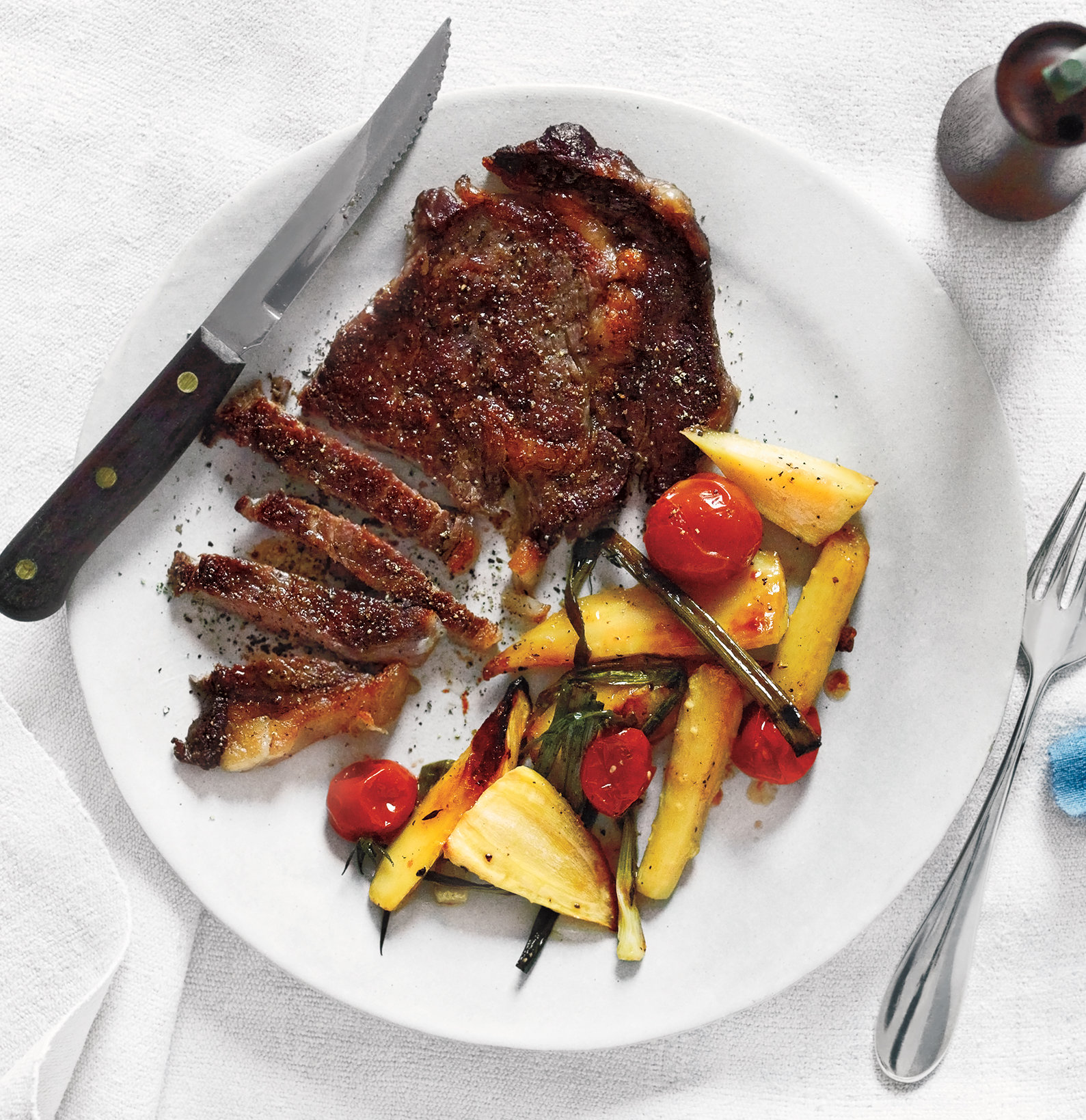 Quick Dinner Ideas: Steak With Roasted Parsnips, Tomatoes, and Scallions