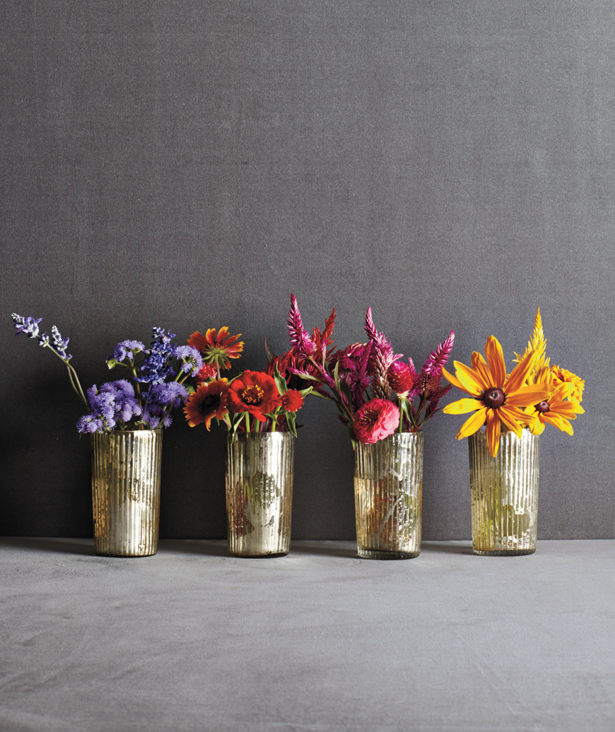 4 vases of flowers, separated by color