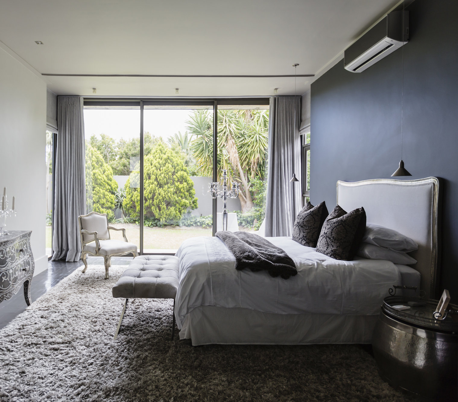 Gray Bedroom With Shag Rug And Sliging Glass Doors
