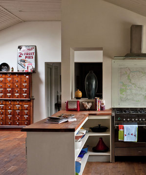Kitchen and adjoining room with antique accents