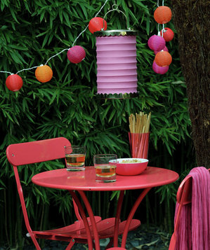 Pink table and chairs with hanging lights