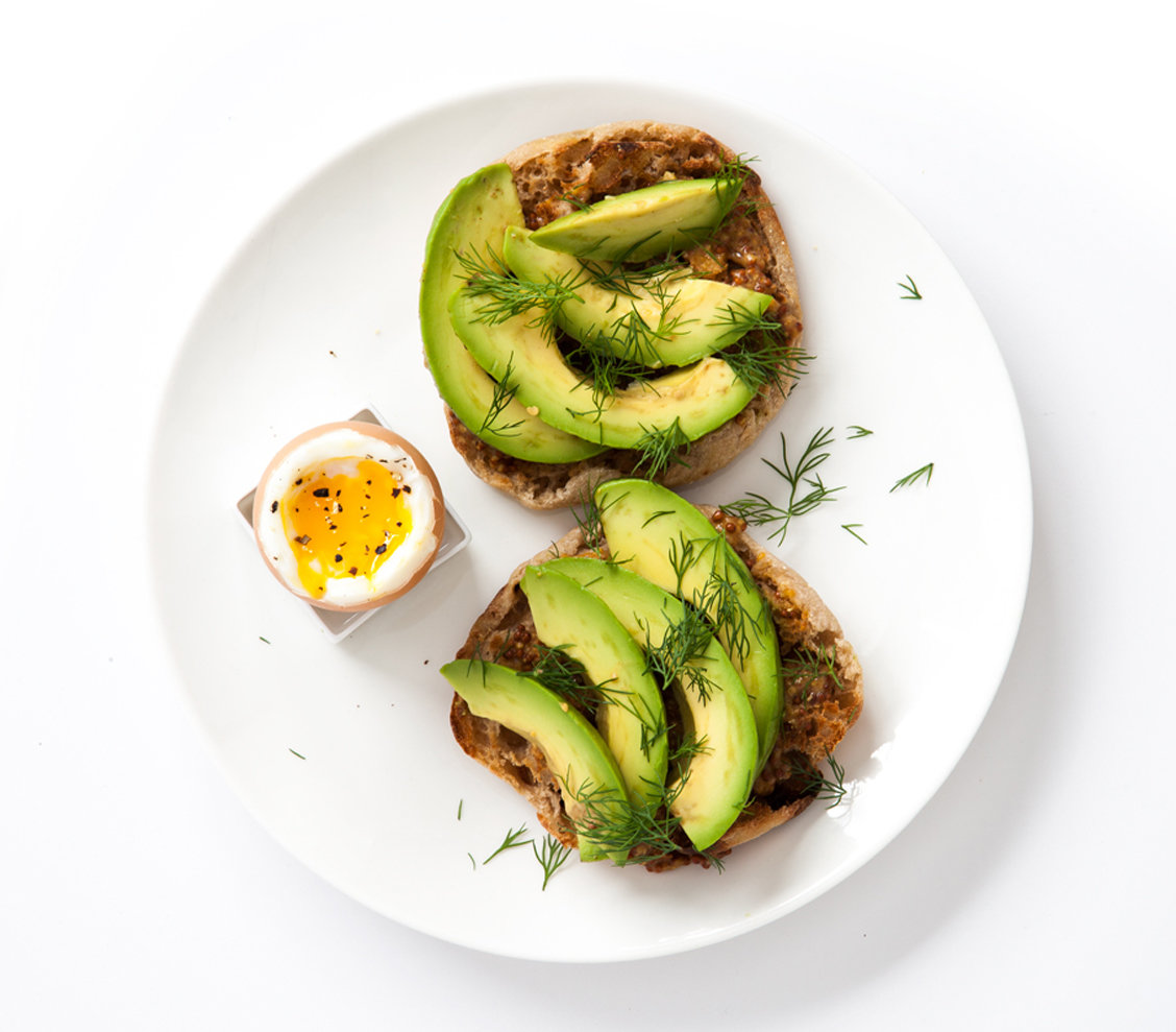 Mustard, Avocado, And Dill On A Whole-Wheat Muffin With