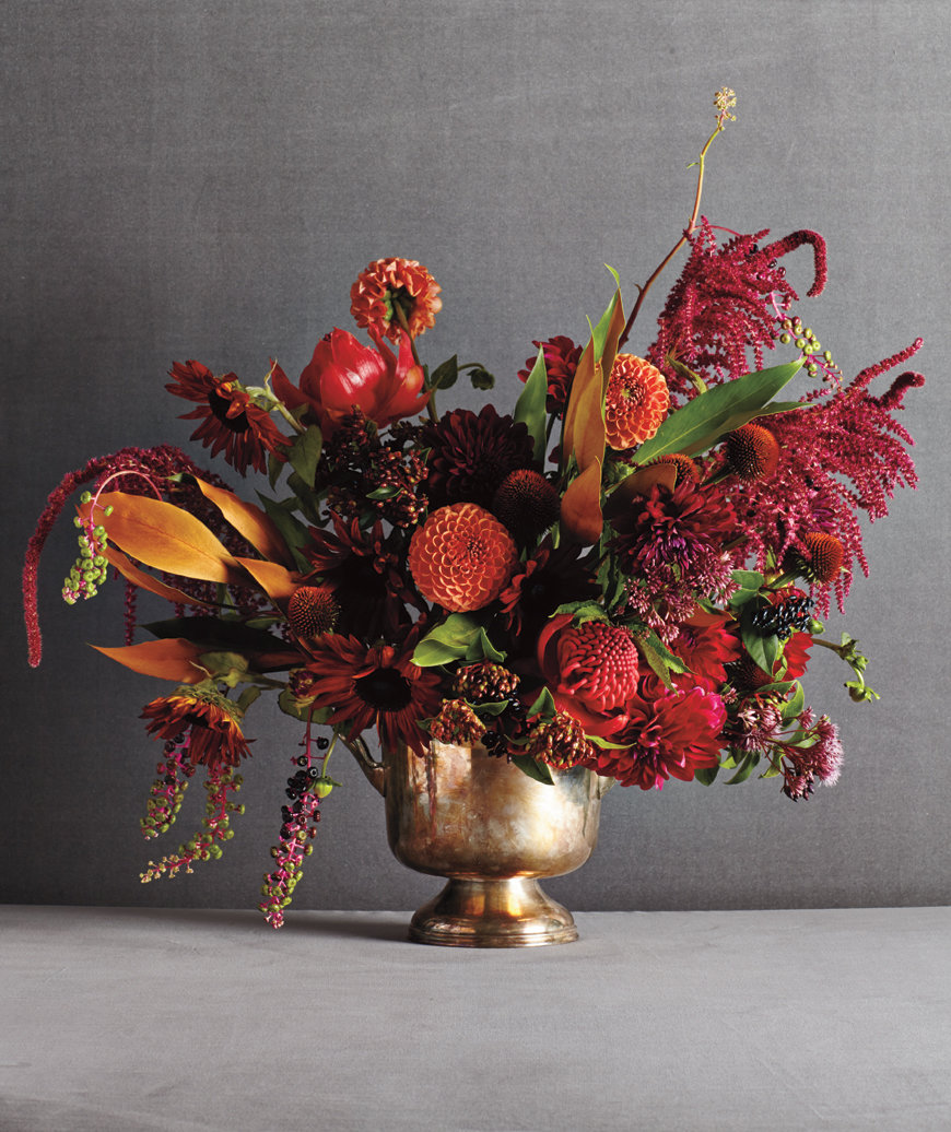 Asymmetrical mix of red and orange flowers