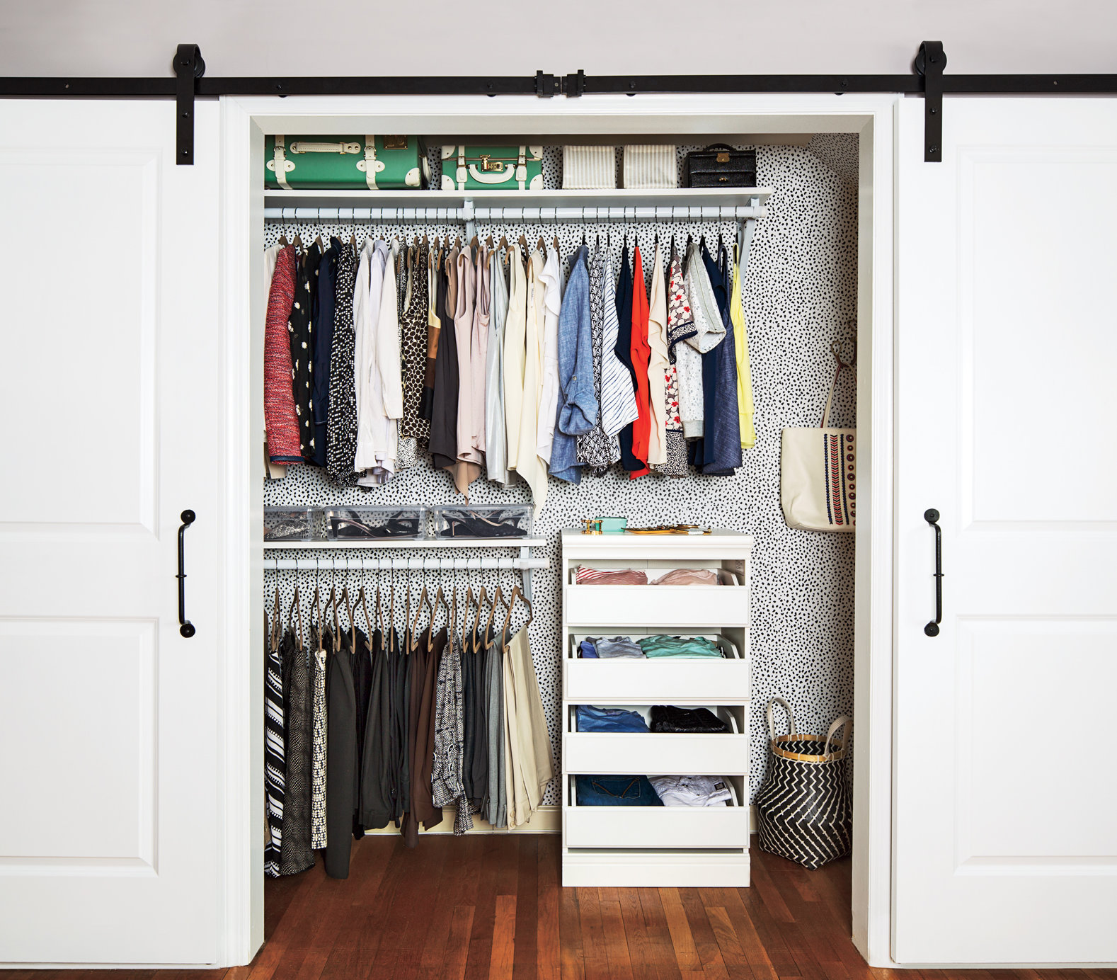 One way to make your bedroom closet feel bigger neater for Small closet barn door