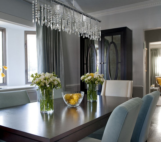 Well accessorized 32 elegant ideas for dining rooms real simple - Dining room crystal chandelier lighting ...