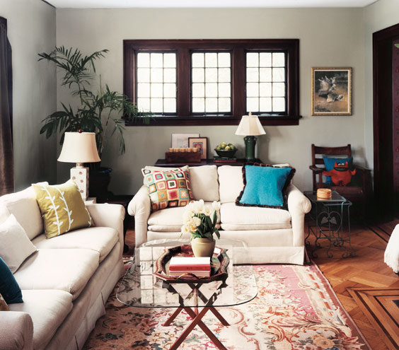 Inject personality into neutral sofas by adding brightly - How to organize your living room furniture ...