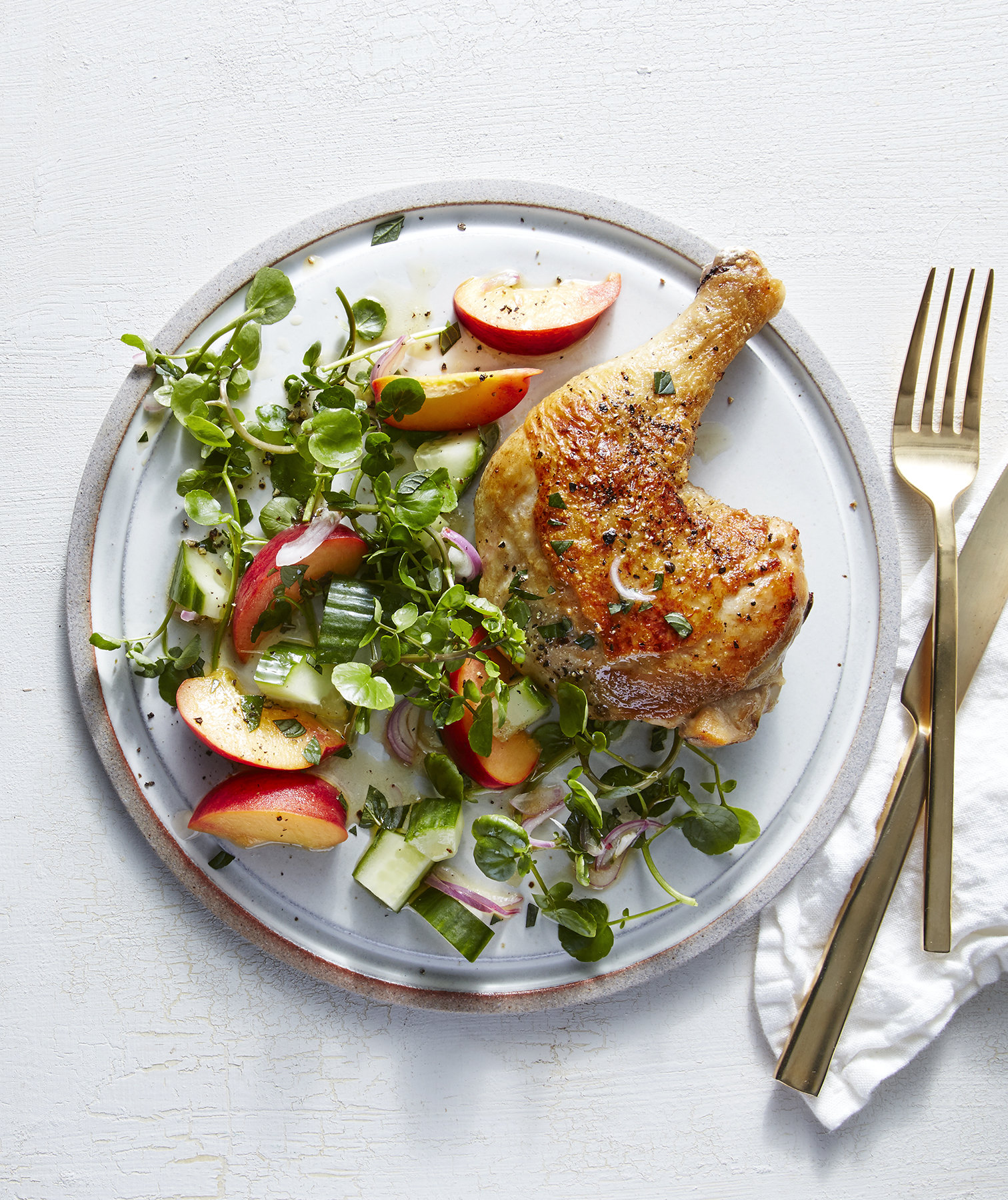 Chicken Legs With Peach, Shallot, and Watercress Salad | Real Simple