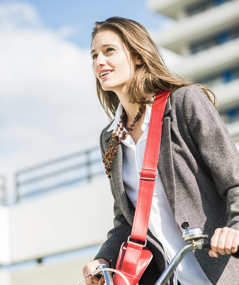smiling-young-woman-bicycle