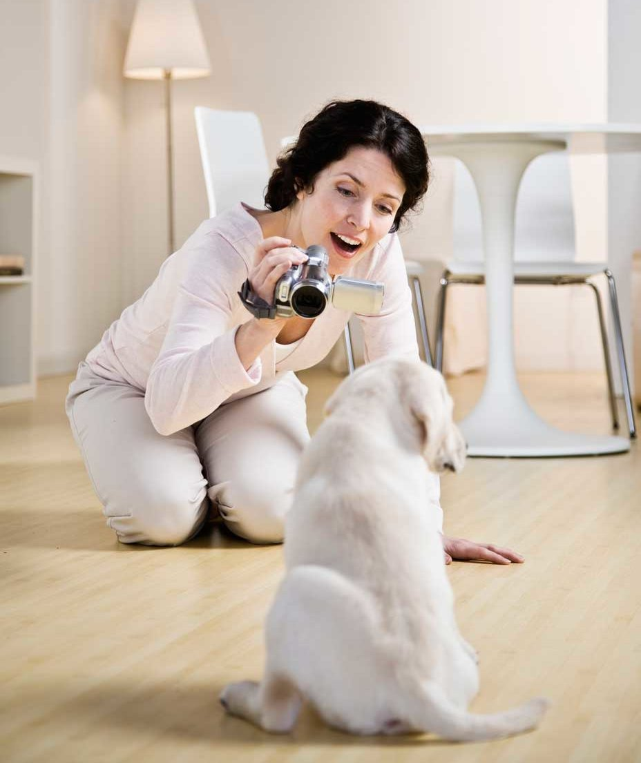 woman-filming-dog