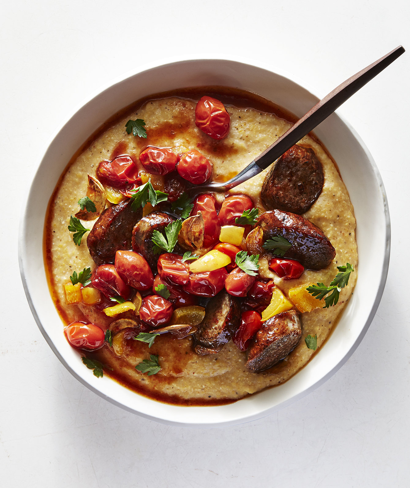 old-bay-cheddar-grits-andouille-tomatoes