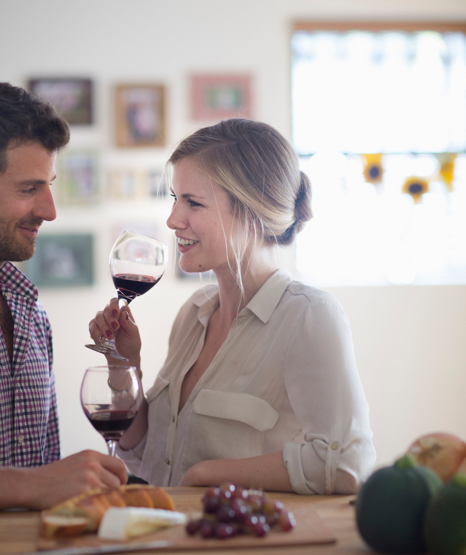 couple-drinking-wine-kitchen