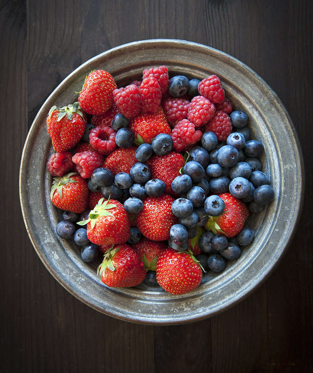 bowl-mixed-berries-dark-background