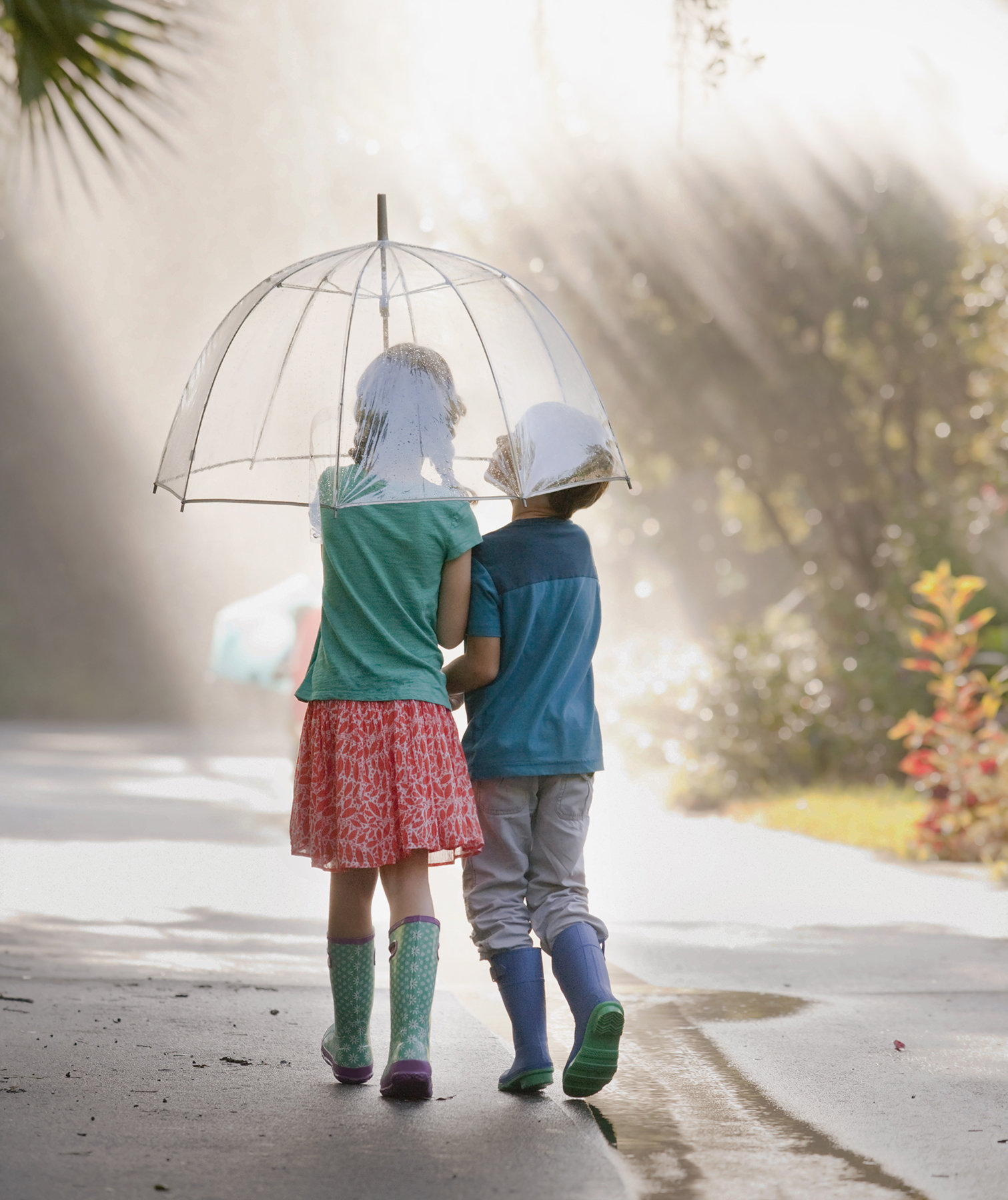 children-walking-umbrella-empathy