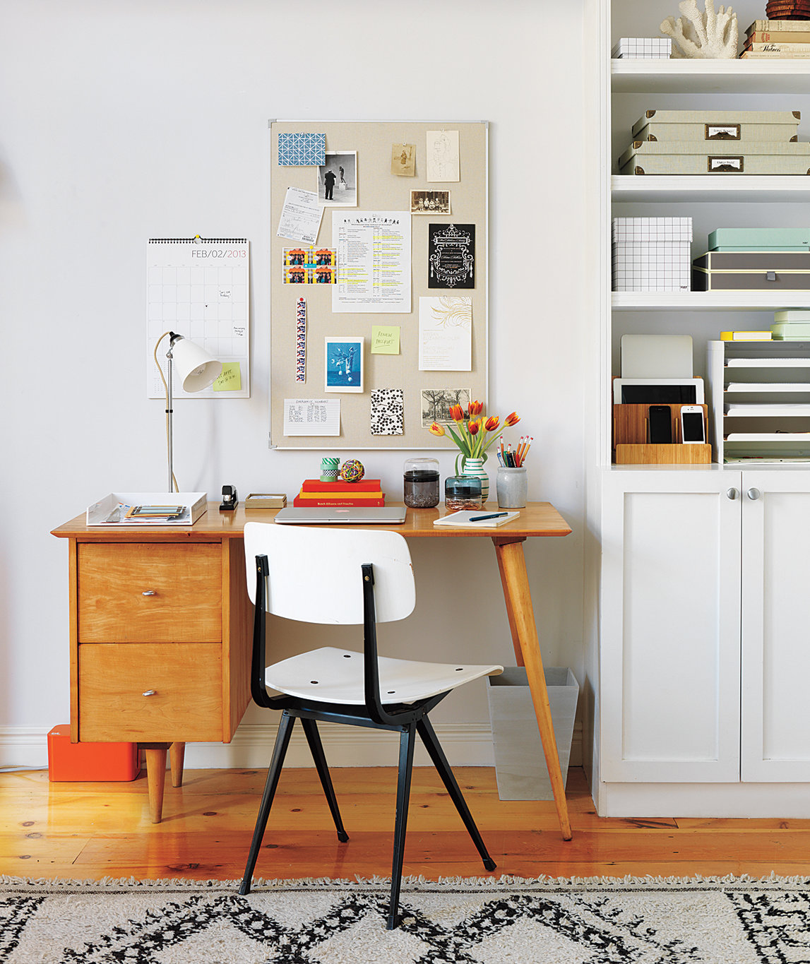desk-white-chair-bulletin-board-wall-shelving