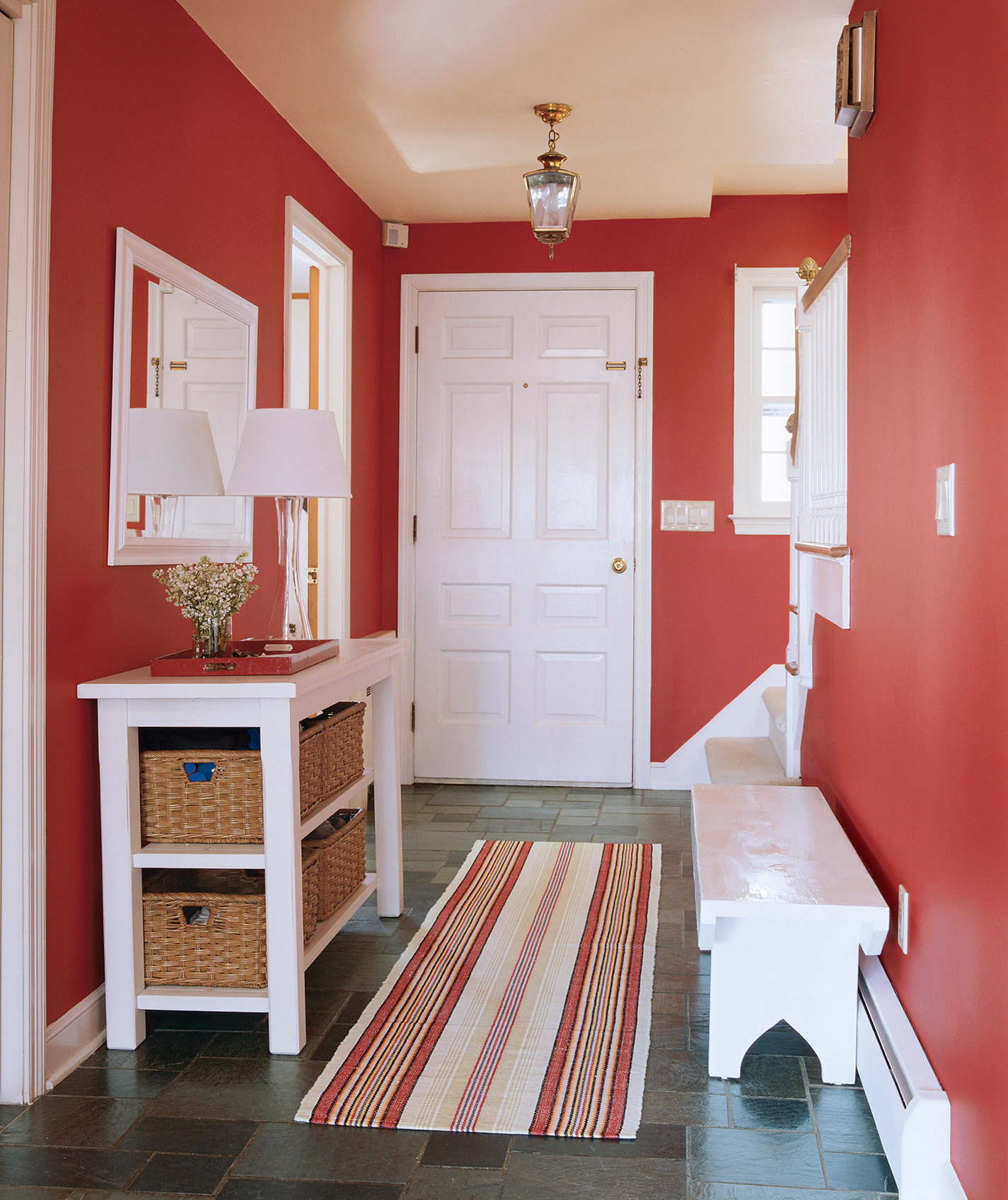 Foyer Area Definition : Define the space with a bold color like this red which