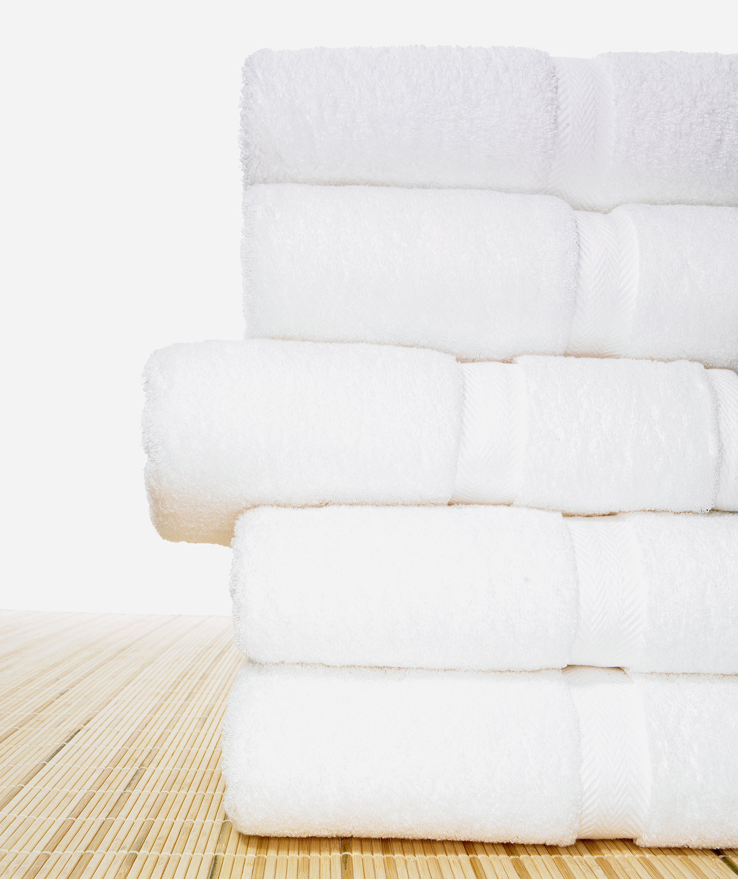 stack-white-folded-towels-bamboo