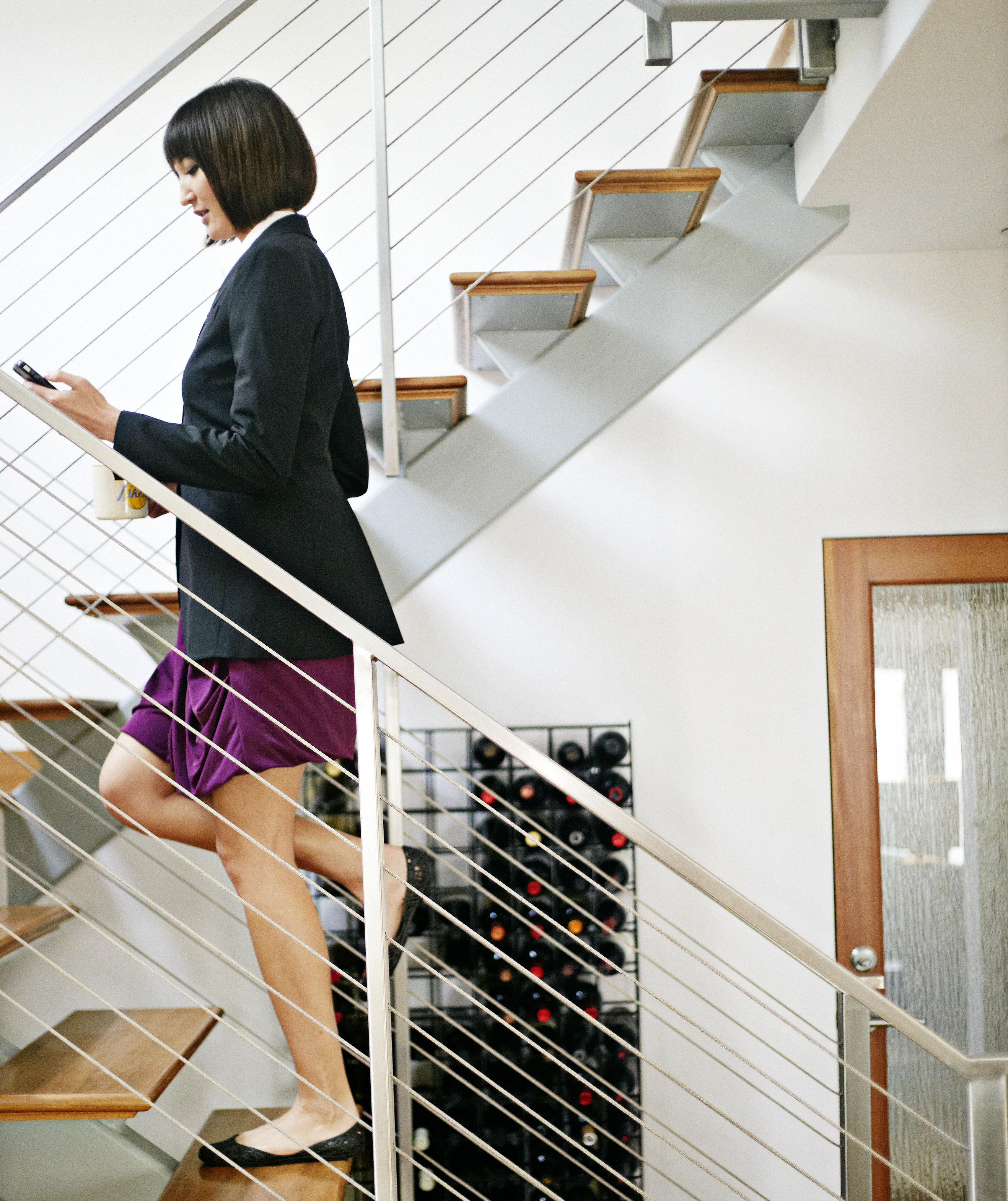 woman-climbing-stairs-texting