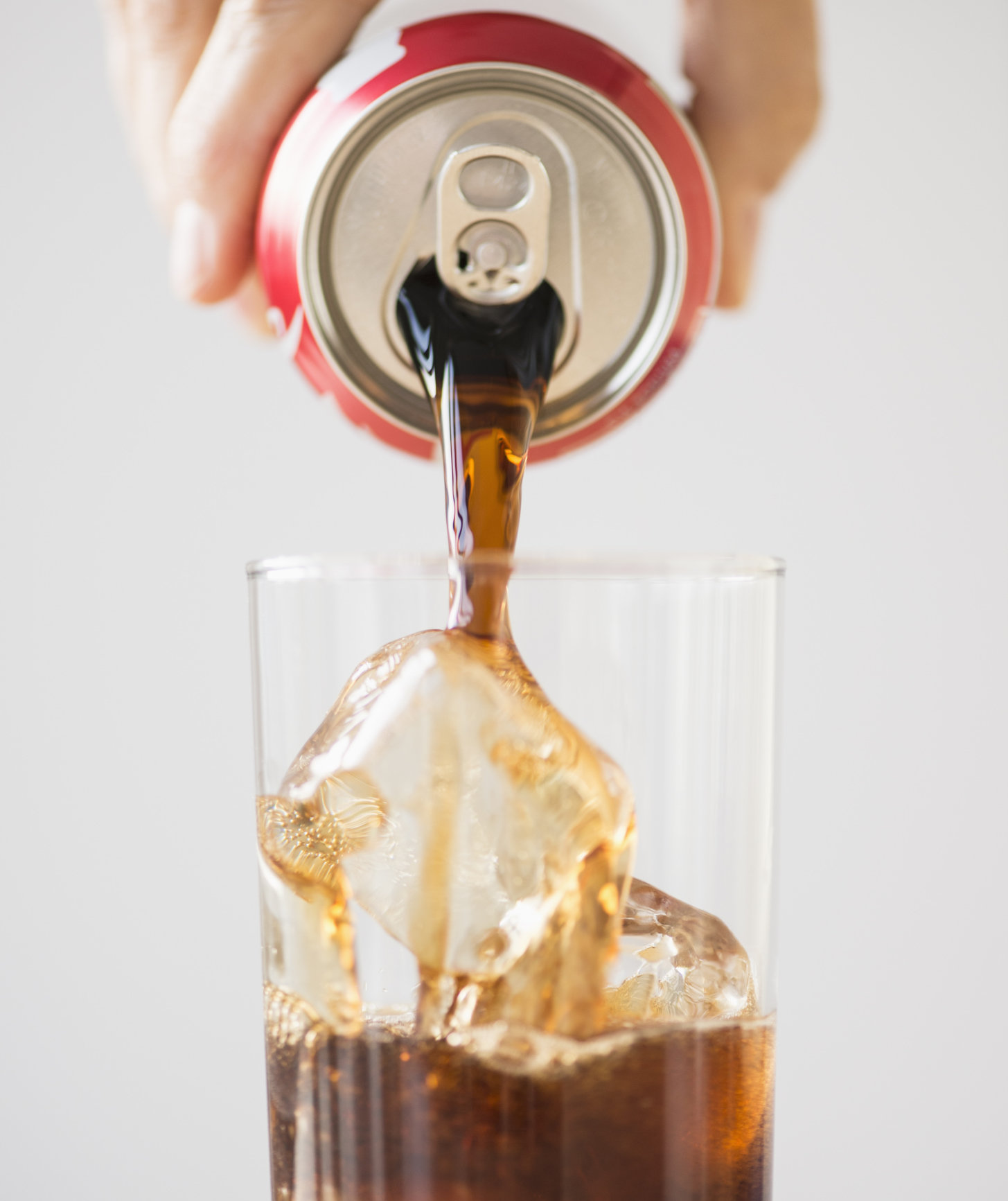hand-pouring-cola