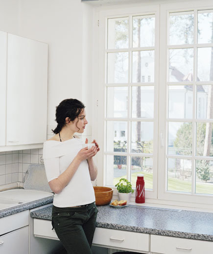 woman-kitchen-cup
