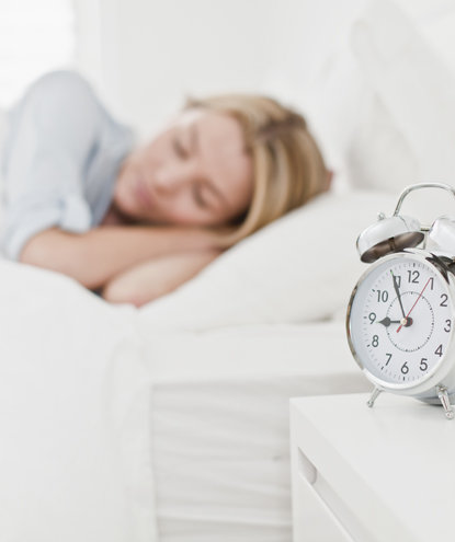 sleeping-woman-alarm-clock
