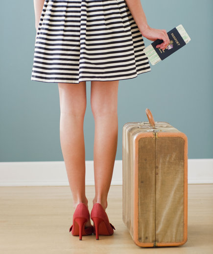 woman-passport-suitcase