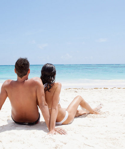 couple-lounging-beach