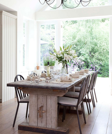 Rustic charm 32 elegant ideas for dining rooms real simple for Long dining room table decor