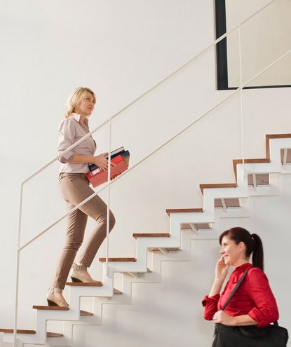 woman-stairs-office-binders