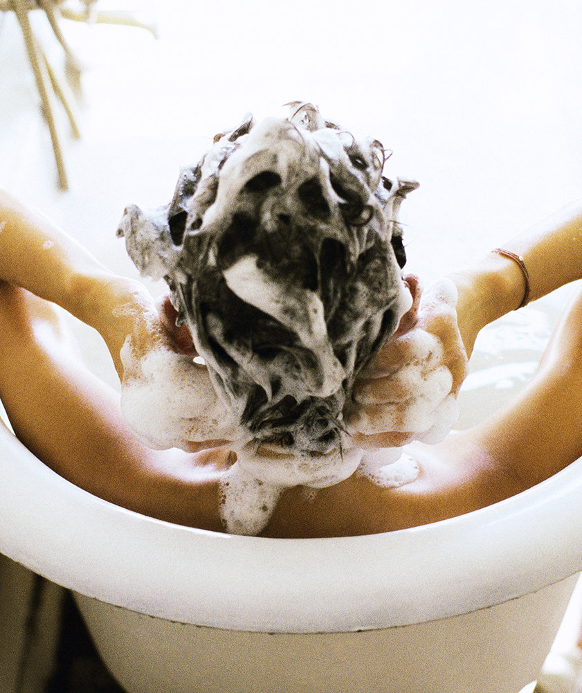 woman-with-shampoo-in-hair
