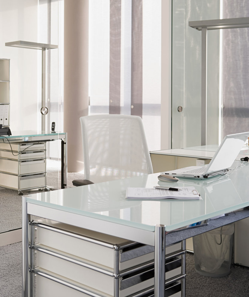 white-office-interior-with-two-desks-drawers-chairs-and-computers-on-desks