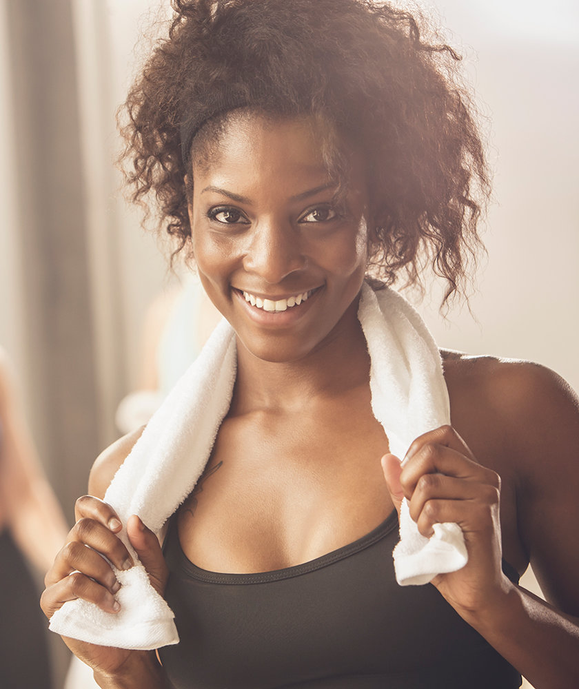 woman-smiling-while-working-out