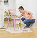 woman-painting-wooden-chair
