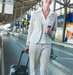 woman-suitcase-travelator