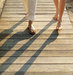 feet-beach-boardwalk