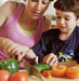 mother-son-chopping-vegetables