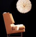 chair-sheepskin-rug-feather-headdress