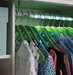 led-closet-rod-shown-with-clothes-on-green-hangers