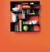 wall-mounted-metal-bookcase-orange-wall