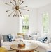 family-room-white-sectional-blue-throw-pillows-cowhide-rug-light-fixture