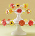 white-cake-stand-orange-yellow-floral-stickers