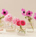 centerpiece-flowers-vases-rubber-bands