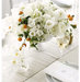 white-ceramic-vase-centerpiece