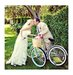 newlyweds-bicycles-kissing