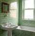 bathroom-green-tiles-pedestal-sink