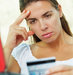 woman-looking-credit-card-worried