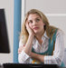 woman-daydreaming-desk