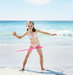 two-girls-hula-hooping-beach