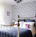 floral-wallpapered-bedroom