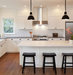 white-kitchen-black-fixtures-stools
