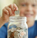 boy-saving-money-coins-jar